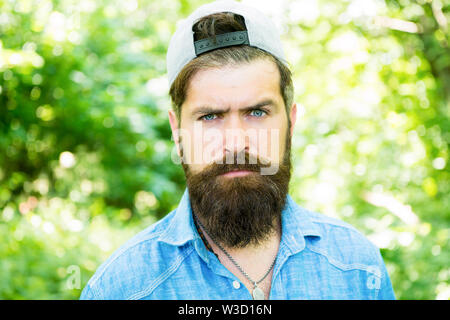 serious bearded man. Mature hipster with beard. male facial care. brutal man with beard. barber. hispter style. Fashion portrait of man. Hair beard care. guy in wood. summer camping. Indulge yourself. - Stock Photo