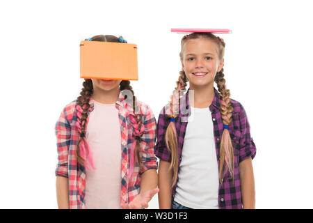 Being genius for hard study. Genius schoolchildren isolated on white. Small girls holding books on heads with genius ideas. The brightest young minds or genius. - Stock Photo