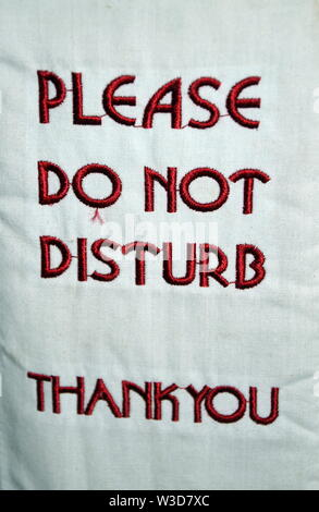 A 'Please Do Not Disturb  Thank You' sign hanging on a hotel room door - Stock Photo