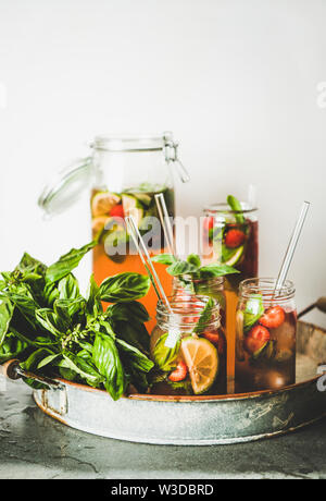 Fresh strawberry and basil lemonade or iced-tea in glasses - Stock Photo
