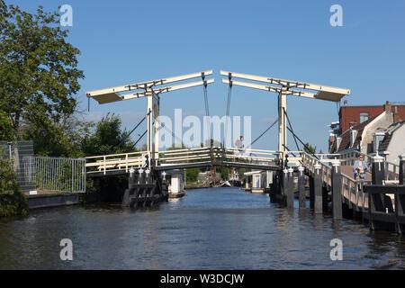 Leiden, Holland - June 26, 2019: Bicycle drawbridge over the Nieuwe Rijn in Leiden - Stock Photo