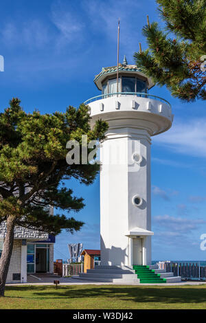 Detail view on main Ganjeolgot Lighthouse, upper direction light near coast. Easternmost Point of Peninsula in Ulsan, South Korea. Asia - Stock Photo