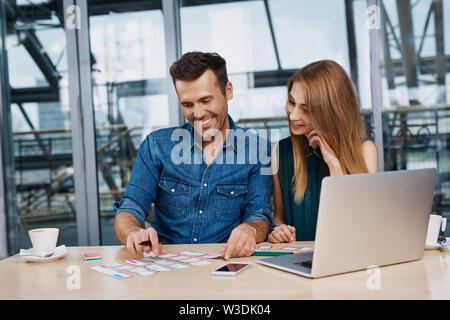 Happy web designers creating responsive design mockup - Stock Photo