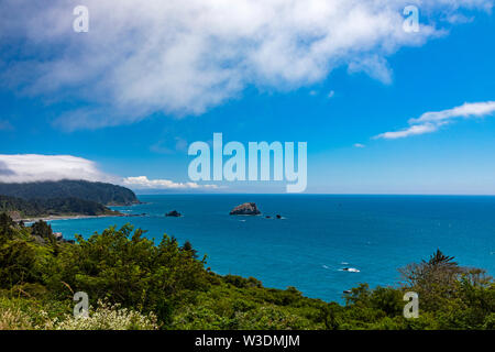 This is a view of the stunning Pacific Ocean coastline as seen from an overlook on Highway 101 about 10 miles south of Crescent City, California, USA. - Stock Photo