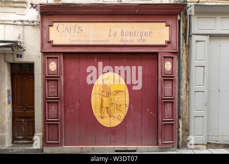 Arles, France - June 24, 2017: Cafe in the old town of Arles in Provence in the South of France. - Stock Photo