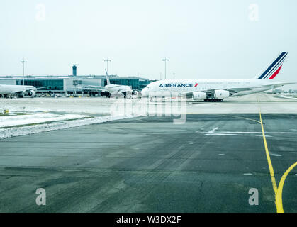 Paris, Charles De Gaulle Airport, Air France Airbus A380 on taxiway tarmac in front of terminal - Stock Photo