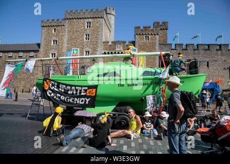 Cardiff, Wales, UK, July 15th 2019. Activists and a boat outside Cardiff Castle as Extinction Rebellion activism closes roads around the city centre. Extinction Rebellion describes itself as an international rebellion against the criminal inaction on the climate and ecological crisis. Credit: Mark Hawkins/Alamy Live News - Stock Photo