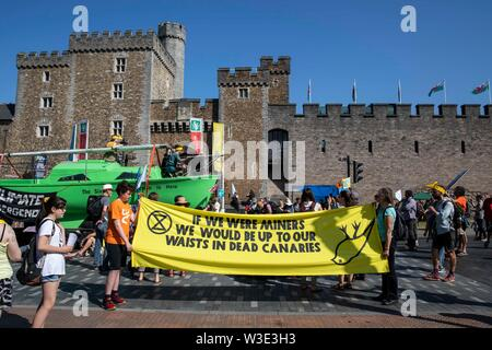 Cardiff, Wales, UK, July 15th 2019. Activists outside Cardiff Castle as Extinction Rebellion activism closes roads around the city centre. Extinction Rebellion describes itself as an international rebellion against the criminal inaction on the climate and ecological crisis. Credit: Mark Hawkins/Alamy Live News - Stock Photo