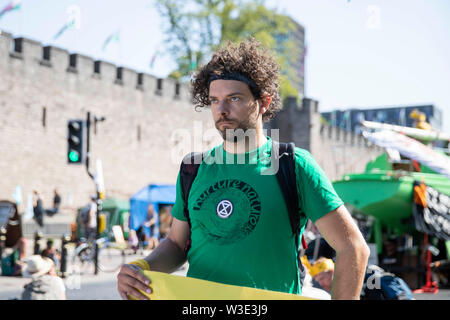 Cardiff, Wales, UK, July 15th 2019. An activist outside Cardiff Castle as Extinction Rebellion activism closes roads around the city centre. Extinction Rebellion describes itself as an international rebellion against the criminal inaction on the climate and ecological crisis. Credit: Mark Hawkins/Alamy Live News - Stock Photo