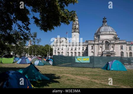 Cardiff, Wales, UK, July 15th 2019. A temporary activist settlement camp outside Cardiff City Hall as Extinction Rebellion activism closes roads around the city centre. Extinction Rebellion describes itself as an international rebellion against the criminal inaction on the climate and ecological crisis. Credit: Mark Hawkins/Alamy Live News - Stock Photo