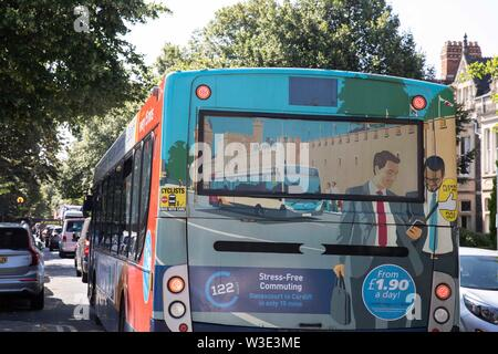 Cardiff, Wales, UK, July 15th 2019. A Cardiff Bus advertising 'Stress-Free Commuting' in gridlocked traffic into Cardiff as Extinction Rebellion activism closes roads around the city centre. Extinction Rebellion describes itself as an international rebellion against the criminal inaction on the climate and ecological crisis. Credit: Mark Hawkins/Alamy Live News - Stock Photo