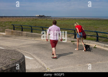 Southport, Merseyside. UK Weather. 15th July, 2019. Sunny start to the day on the seafront promenade, as joggers, walkers and cyclists enjoy the warming morning temperatures in bright sunshine. Credit; MediaWorldImages/AlamyLiveNews. - Stock Photo
