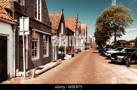 Beautiful little houses, town famous for its cheese production, stylish vintage city, nice European architecture, Edam, North Holland - Stock Photo