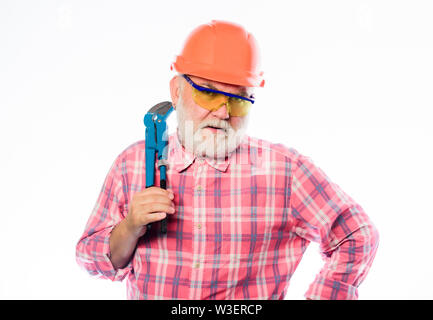 architect repair and fix. engineer worker. build and construction. professional repairman in helmet with gas wrench. mature bearded man in hardhat. man builder. Everything should be perfect. - Stock Photo