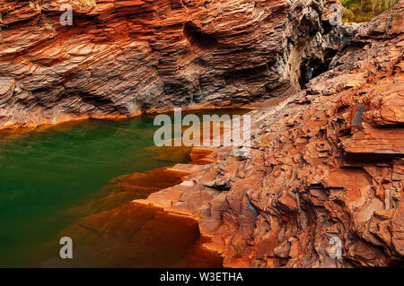 Karijini National Park is where the green water meets red rocks. - Stock Photo