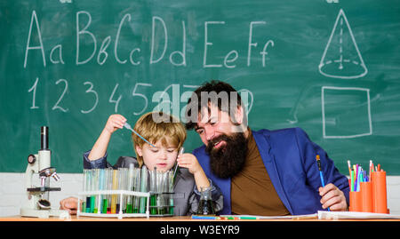 Wisdom. Back to school. son and father at school. Formula. experiments in organic chemistry laboratory. biotechnology research concept. small boy with teacher man. Education changes - Stock Photo