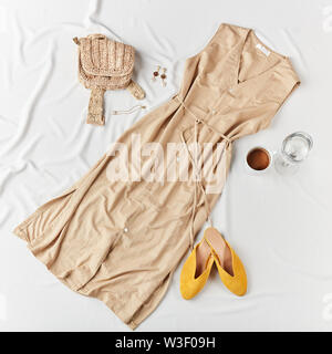 Women's fashion clothes on white background. Flat lay . Top view.elegant dress for a party - Stock Photo