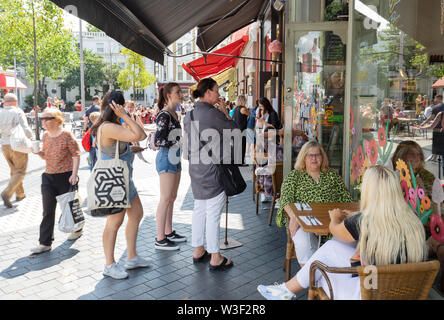 South Kensington London UK; people eating and drinking at street cafes on a sunny summer day; South Kensington, London UK - Stock Photo