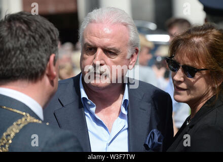 Broadcaster Marty Whelan arrives for the funeral of Father Ted star Brendan Grace at the Church of St. Nicholas of Myra, Dublin. - Stock Photo