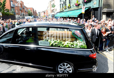 The coffin of Father Ted star Brendan Grace is carried by a hearse after his funeral at the Church of St. Nicholas of Myra, Dublin. - Stock Photo