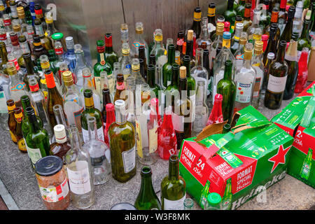 Lots of empty glass bottles in a glass container for recycling. Bordeaux, Gironde. Aquitaine region. France Europe - Stock Photo