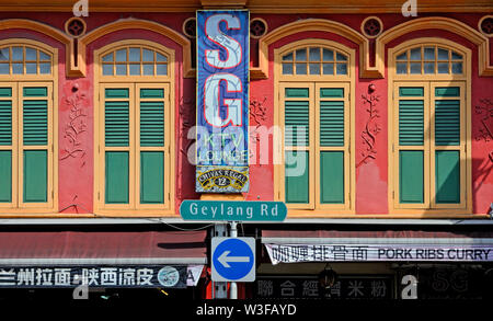singapore, singapore - november 19, 2011: the facade of a traditional house on geylang road in geylang - Stock Photo
