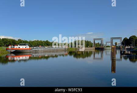 papenburg, niedersachsen/germany - august 24, 2014: the most northerly locks at the end of  dortmund ems canal at km 213.5 near herbrum and a inland w - Stock Photo
