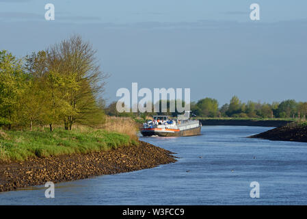 papenburg, niedersachsen/germany - may 04, 2015: an inland waterway tanker vessel making it to the north on ems river after having passed herbrum dort - Stock Photo
