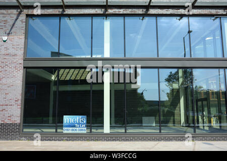 Glass curtain wall on empty to let commercial building in bury lancashire uk - Stock Photo