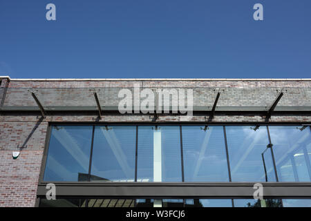 Glass curtain wall and cantilevered glass canopy on commercial building in bury lancashire uk - Stock Photo