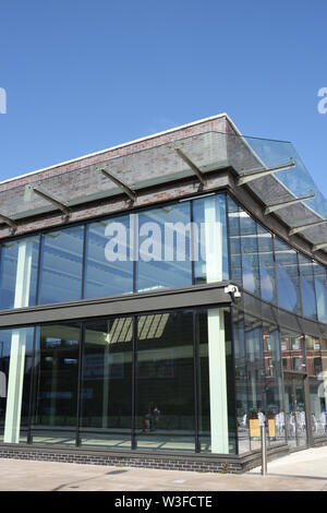 Glass curtain walling and cantilevered glass canopy in bury lancashire uk - Stock Photo
