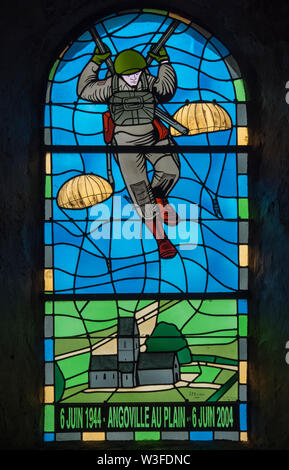 Stained glass window dedicated to the 101st Airborne paratroopers in the church at Angoville-au-Plain, Manche, Normandy, France - Stock Photo