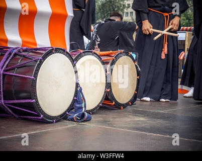 Taiko drums o-kedo are in a row and japanese drummers on the Yagura stage get ready to play. Musical instrument of Asia Korea, Japan, China - Stock Photo