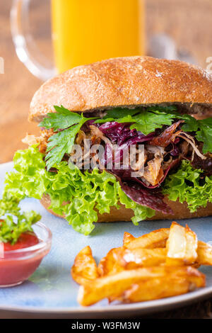 pulled pork in a bun with beer - Stock Photo