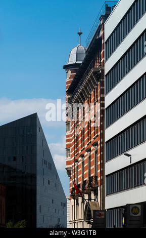 Contrasting architecture in Liverpool, England. 30 James Street Hotel in the center was once the home of the RMS Titanic - Stock Photo