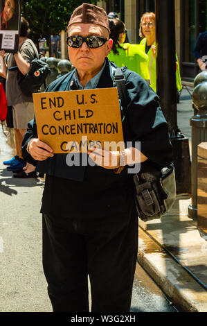 Downtown, Chicago-July 13, 2019: Protest against ICE and Customs and Border Patrol Detention Centers. A man holds a sign that reads 'End US Child Conc - Stock Photo