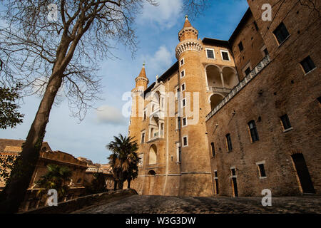 Urbino Marche Italy. Ducal Palace or Palazzo Ducale in morning light. Point of view - Stock Photo