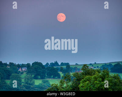 UK Weather: spectacular orange full Buck moon over  Wirksworth Derbyshire UK