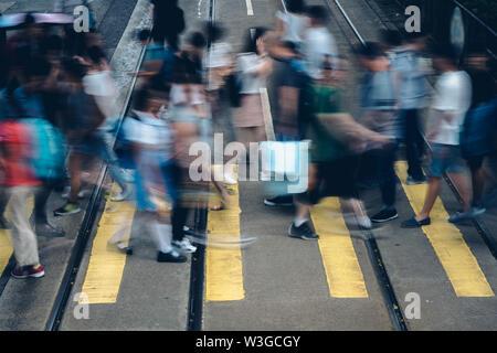 Pedestrian crossing at Busy City, Hong Kong - Stock Photo
