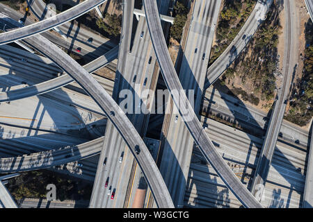 Afternoon aerial above the Harbor 110 and Century 105 freeways interchange ramps in Los Angeles, California.