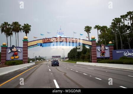 Driving into walt disney world orlando Florida USA - Stock Photo