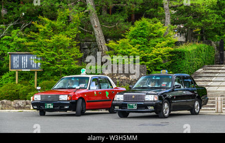 Kyoto, Japan - Jun 24, 2019. Taxis waiting on street in Kyoto, Japan. Taxis are expensive, and not convenient for travelers in Japan. - Stock Photo