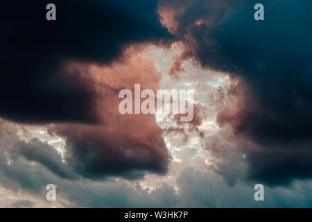 A beautiful shot of breathtaking clouds in the sky mixing together - Stock Photo