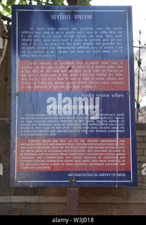 Protected Monument signboard installed by Archaeological Survey of India in front of Zafar Mahal Palace, Mehrauli, Delhi, India - Stock Photo