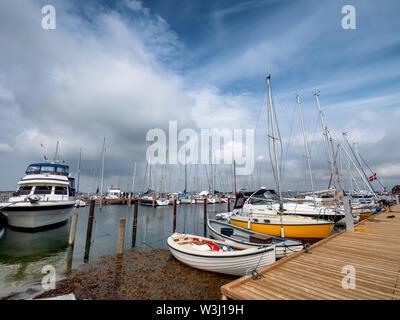 Small harbor marina on Lyoe in the archipelago in Denmark - Stock Photo