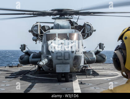 190629-M-QS181-1059 GULF OF ADEN (June 29, 2019) A U.S. Marine Corps CH-53E Super Stallion with Marine Medium Tiltrotor Squadron (VMM) 163 (Reinforced), 11th Marine Expeditionary Unit (MEU), sits on the flight deck of the Harpers Ferry-class amphibious dock landing ship USS Harpers Ferry (LSD 49) during flight operations. The Boxer Amphibious Ready Group and the 11th MEU are deployed to the U.S. 5th Fleet area of operations in support of naval operations to ensure maritime stability and security in the Central Region, connecting the Mediterranean and the Pacific through the Western Indian Ocea - Stock Photo