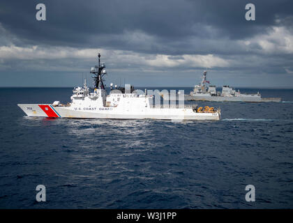 190711-N-WK982-3009 CORAL SEA (July 11, 2019) The U.S. Coast Guard Legend-class cutter USCGC Stratton (WMSL 752), left, and the U.S. Navy Arleigh Burke-class guided-missile destroyer USS McCampbell (DDG 85) maneuver into formation during Talisman Sabre 2019. Talisman Sabre 2019 illustrates the closeness of the Australian and U.S. alliance and the strength of the military-to-military relationship. This is the eighth iteration of this exercise. (U.S. Navy photo by Mass Communication Specialist 2nd Class John Harris/Released) - Stock Photo