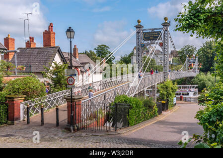 Queens Park suspension bridge over the river Dee at Chester. - Stock Photo