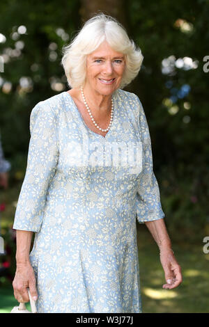 The Duchess of Cornwall arrives for a garden party to celebrate the 50th anniversary of Ginsters bakery in Callington, as part of their visit to Cornwall. - Stock Photo