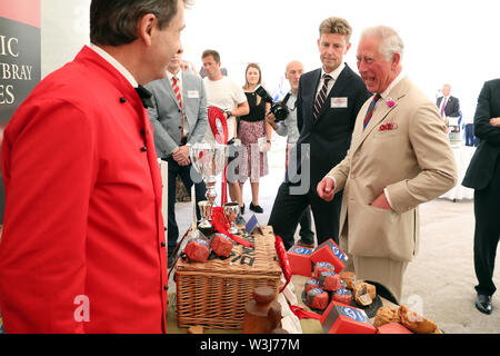 The Prince of Wales during a garden party to celebrate the 50th anniversary of Ginsters bakery in Callington, as part of their visit to Cornwall. - Stock Photo